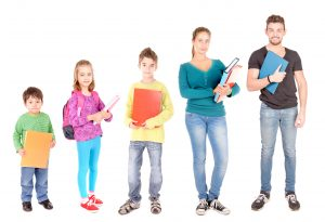 Picture of family holding binders