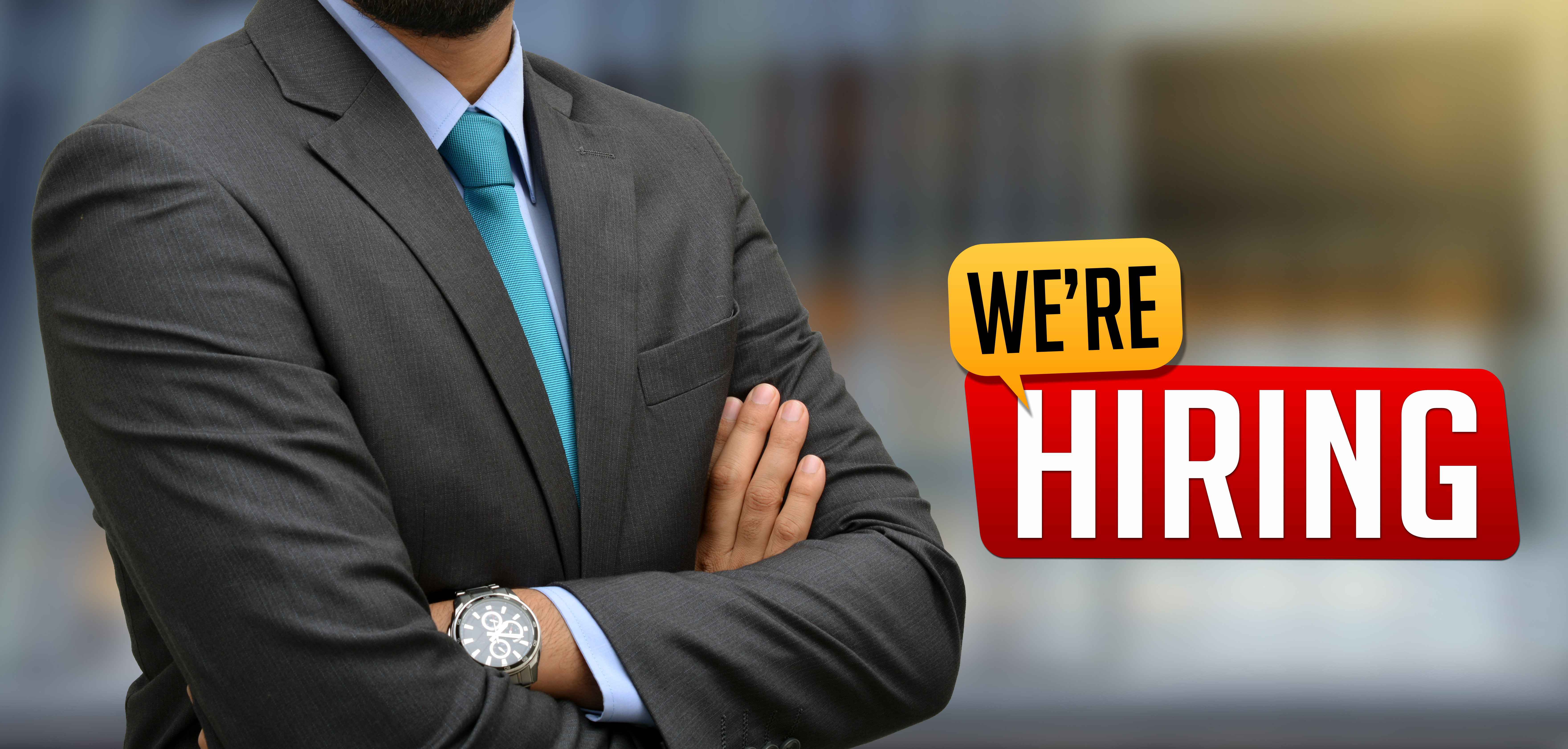 Professional with We are hiring Sign Banner.